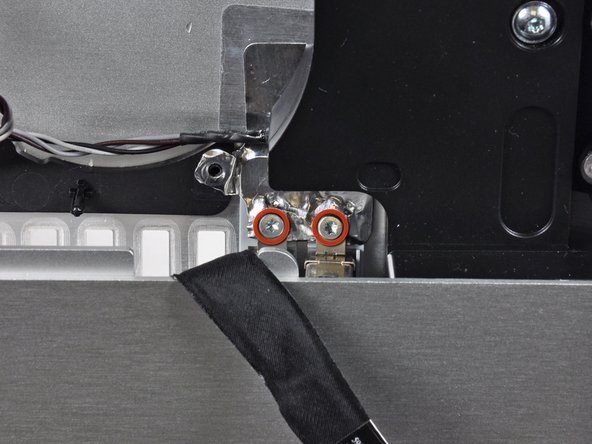 Remove two T10 Torx screws securing the audio ports to the outer case.