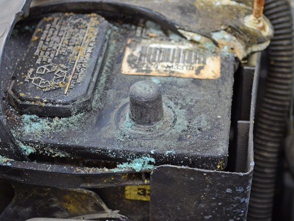 Scrape the corrosion off of the battery terminal using a wire battery brush or some other scraping/brushing tool.