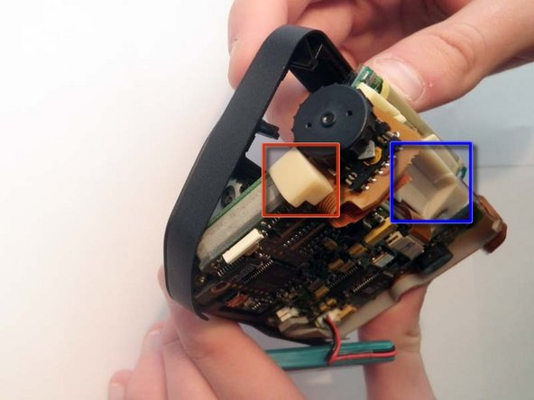 Carefully remove the board from the device by gently pushing on the screen from the front side. The battery, screen, and scroll wheel are all connected to the logic board. Be sure to support these components so they do not break.