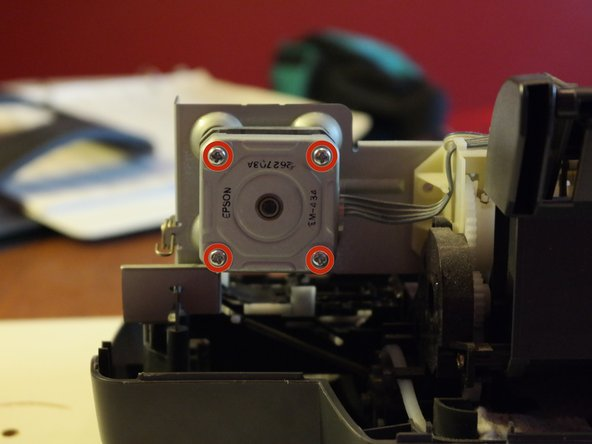 After removing 4 screws, the stepper motor comes out.