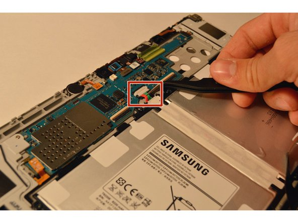 Using tweezers, remove the top center 6 pin power connector that is attached to the edge of the motherboard from the center of the battery. To unplug it, pull it upwards away from the motherboard.