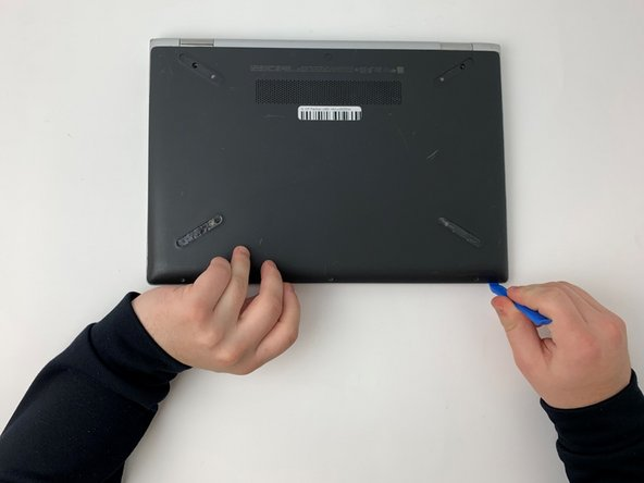 Using the opening tool, carefully remove the bottom cover from the device.