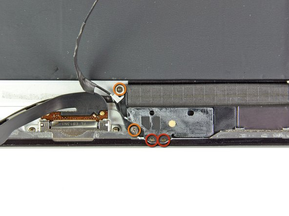 Remove the following screws securing the bluetooth/wi-fi antenna to the rear panel: