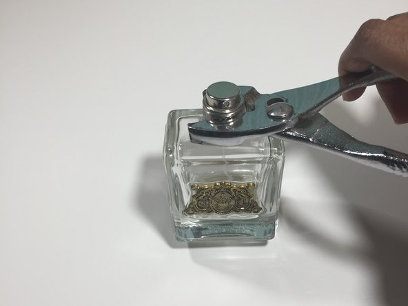 Remove  the nozzle from the bottle by taking the pliers and unscrewing the nozzle counter clockwise.