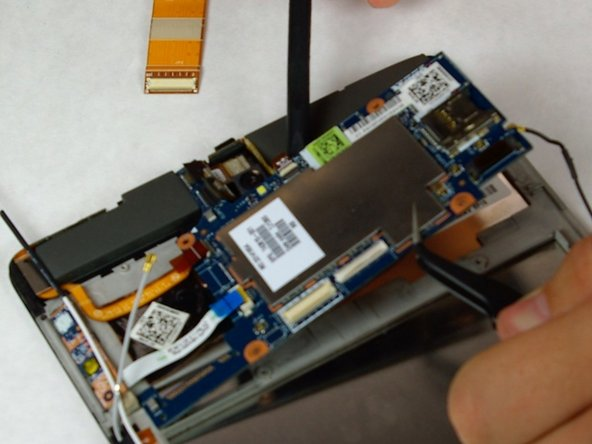 Use tweezers and a spudger to remove the motherboard.