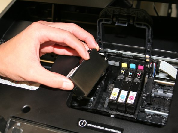 Pull the cartridge out, and place the new ink cartridge back into the slot. Push until you hear a click.