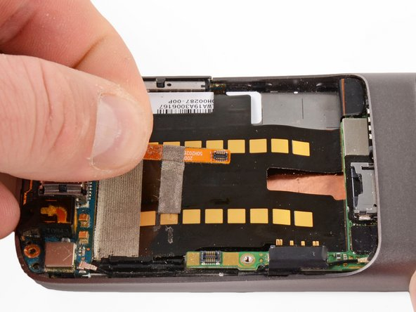 Pull up on the ribbon cable, the tape will detach from the main board ribbon.