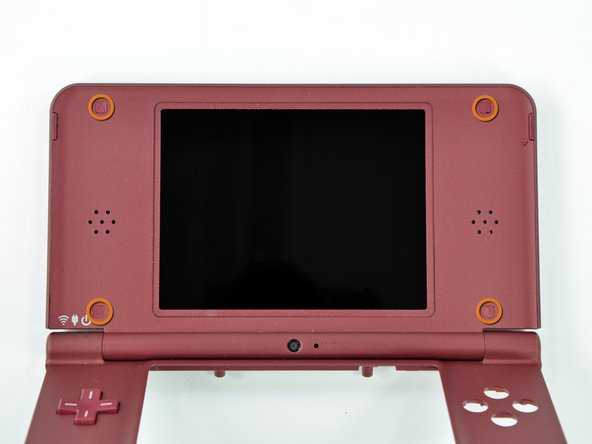 Turn the DSi XL over and open the display.