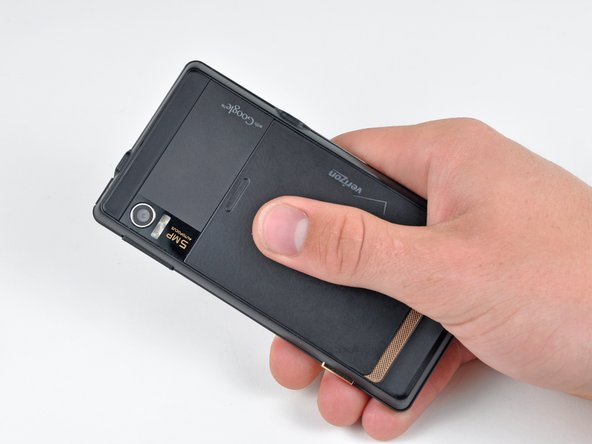 Slide the battery cover downwards while applying pressure to the center of the battery cover with your thumb.