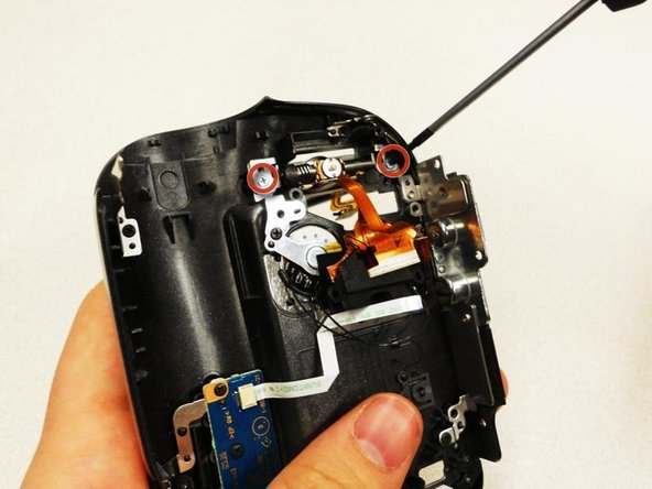 Remove (2) 5.4mm screws that are securing the screen to the cover, from the base of the LCD.