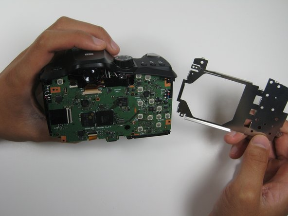 After loosening the frame with the opening tools, gently remove the frame from the interior of the camera.