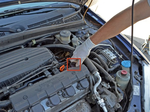 Locate your oil filler cap.  It's on the top-right of your engine block. Unscrew it (counter-clockwise).