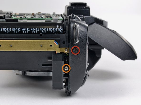 Remove the following two screws securing the top cover to the D70 near the shutter button: