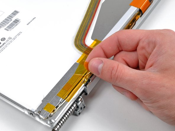 Remove the piece of tape securing the backlight cables to the front display bezel.