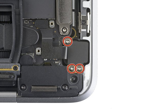 Use a T3 Torx driver to remove the three 4.4mm screws securing the headphone jack to the case.