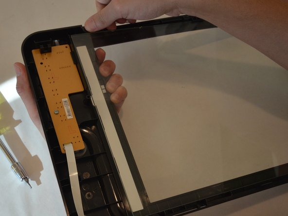 To remove the scanner glass, gently push it towards you.