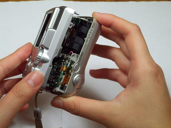 Carefully pull the front and back case apart.