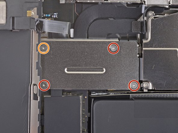 Use a Y000 driver to remove four screws securing the front sensor connector cover.