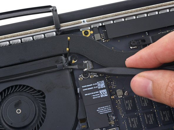 Use the tip of a spudger to push the camera cable connector out of its socket on the logic board.