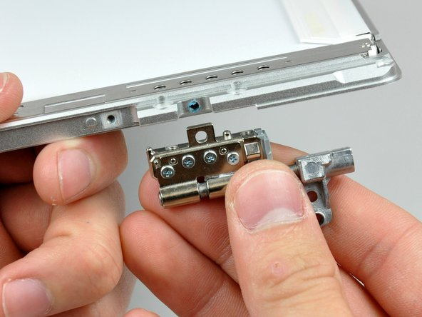 Remove the left clutch hinge from the front bezel.