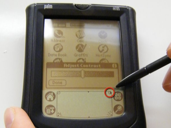 Turn on the Palm m105. Press the Contrast icon (circle that is half filled) in the upper-right corner of the stylus writing area.  If the contrast dialog box appears, adjust the contrast level by holding down the 'up' scroll button for 3 seconds to increase contrast or the 'down' scroll button to decrease contrast.
