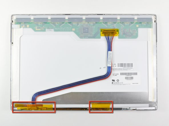 If present, remove the pieces of tape stuck to the lower edge of the LCD.