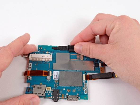 Starting at the right side, gently lift and remove the black casing that once held the camera.