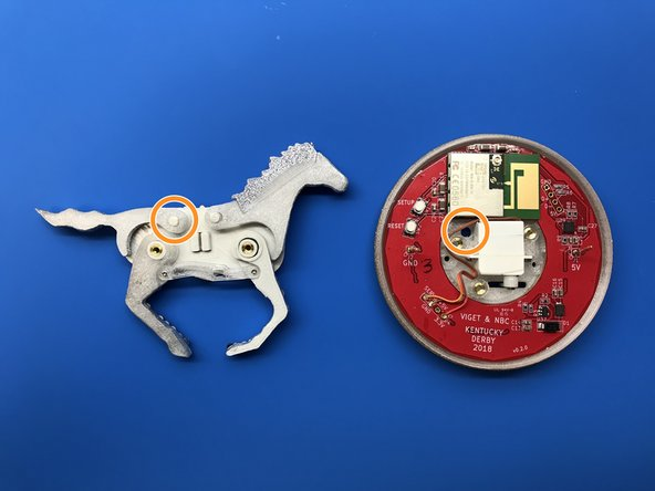 Align the enclosure with the mounting holes on the backside of the horse's body.