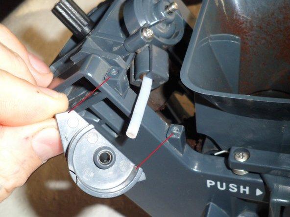 Remove the retaining bracket.