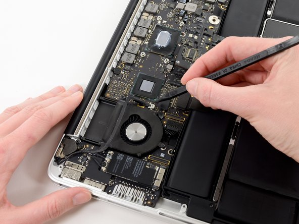 Use the tip of a spudger to push the iSight camera cable connector straight away from its socket on the logic board.