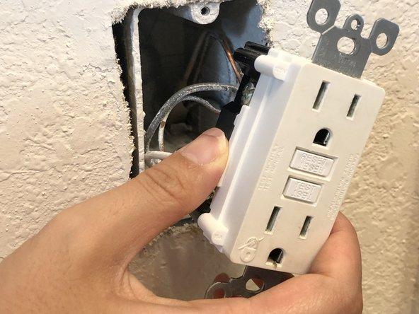 Pull the outlet out from the interior outlet box, exposing the wires that are inside the electrical box.