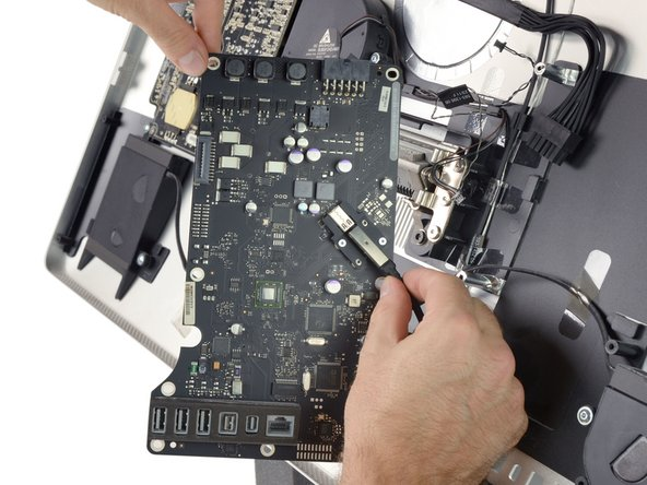 Unplug the Thunderbolt cable from the logic board.