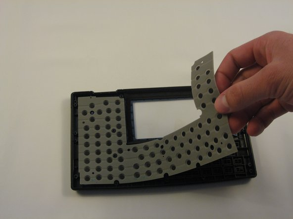 The rubber mat in back of the faceplate may be removed, exposing all 77 individual plastic keys.
