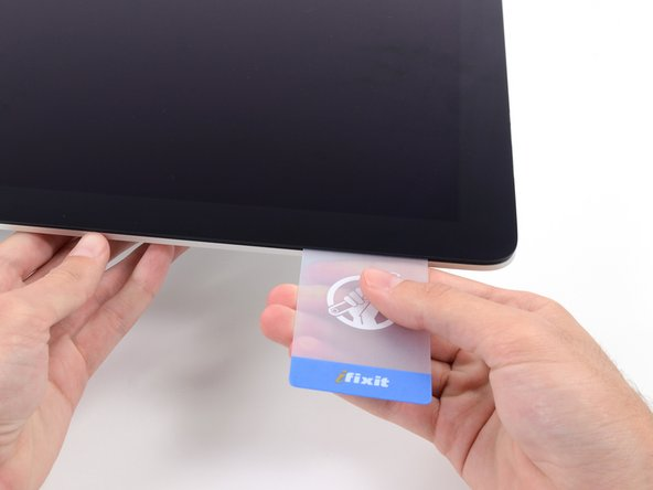 Gently twist the card, slightly increasing the space between the display and frame.