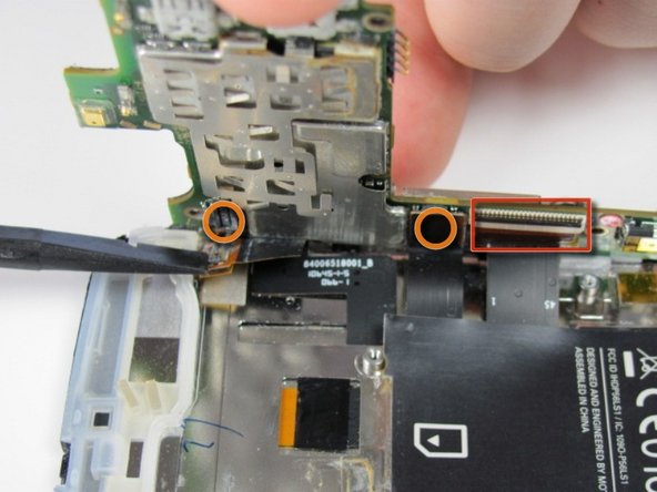 First, several connections must be disconnected to completely separate the motherboard from the rest of the phone.