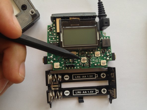 With a spudger o a small flat head screwdriver, carefully remove tactile switch.