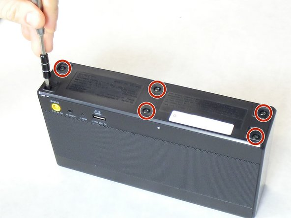 Locate the six 9 mm screws on the bottom of the speaker and remove them using Phillips head #2.