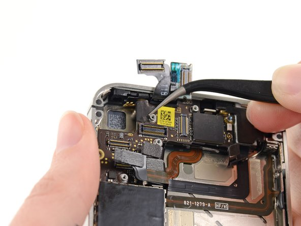 If present, remove the piece of tape covering a Phillips screw near the power button.