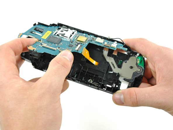 Lift the motherboard up from its bottom edge about 45 degrees from the case.