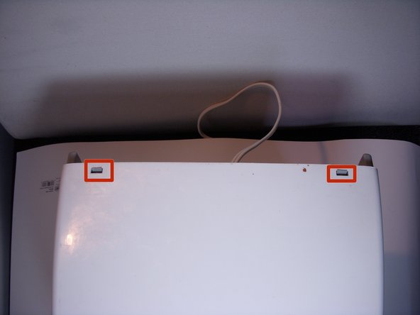 Look for the plastic clips on the back side of the toaster.