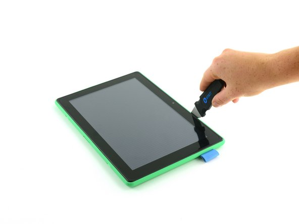 Insert a Jimmy or other prying tool into the seam between the screen and  back case.