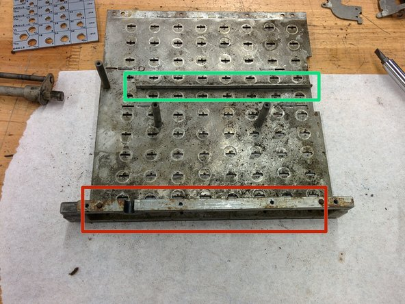 Turn the keyboard plate over and remove the frame piece.