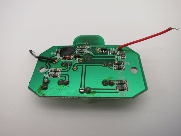 Separate the circuit board from the battery holder by desoldering the black and red wires from the battery holder.