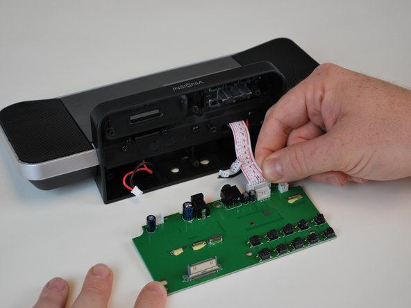 Remove the LCD screen plug last. For reassembly, follow the instructions in reverse order, replacing the old motherboard with the new one to fix the power auxiliary port.