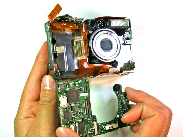 Remove the motherboard from the main frame of the camera body.