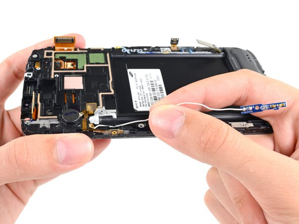 Remove the antenna cable from the display assembly.