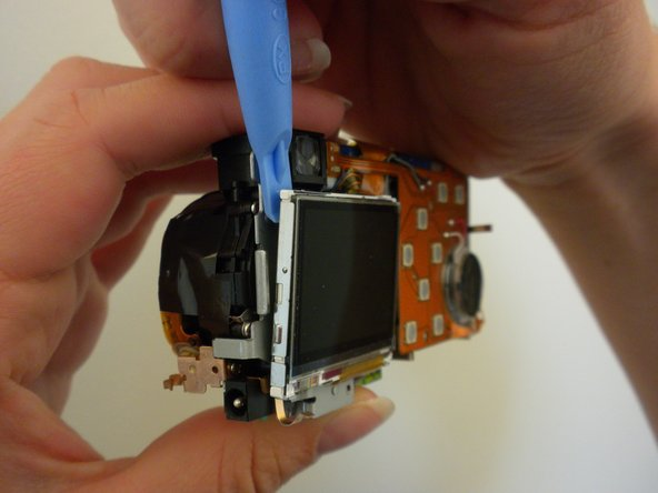 Pry off the LCD screen from the top using a spudger.  The screen will not be completely free from the device because of a ribbon.