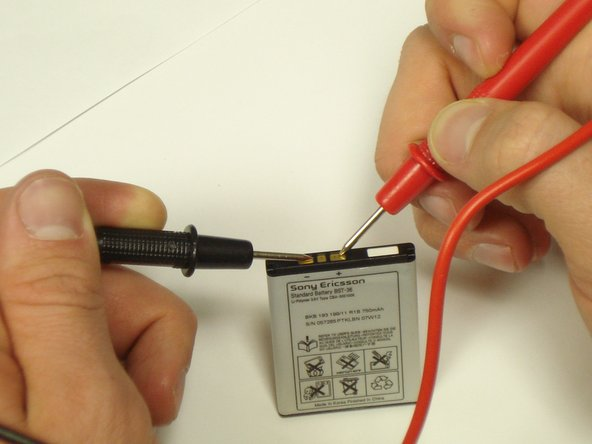 Touch the red probe to the indicated positive side and the black probe to the indicated negative side.