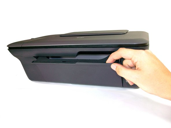 Place your index finger in the opening on the front of the printer (right side below scanner/copier) and pull the door down.