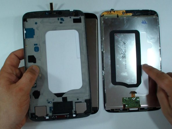 Transfer the black tape from the old display. It keeps the distance the display from the battery and protects it from overheat.